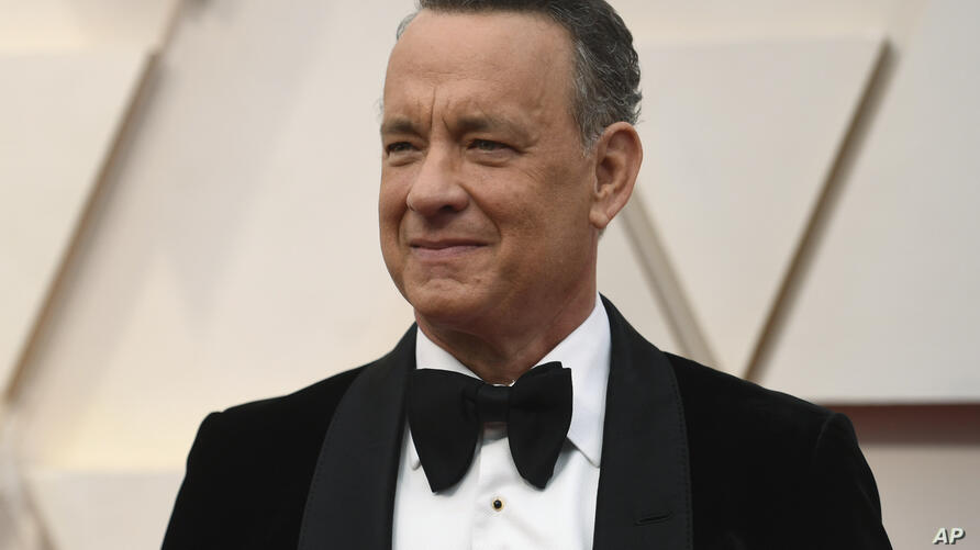 FILE In this Feb. 9, 2020 file photo Tom Hanks arrives at the Oscars at the Dolby Theatre in Los Angeles. The actor delivered a…