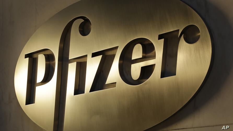 FILE - In this Nov. 23, 2015, file photo, the Pfizer logo is displayed at world headquarters in New York. Pfizer says it's…
