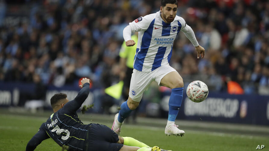 Brighton's Alireza Jahanbakhsh, right, is tackled by Manchester City's Danilo during the English FA Cup semifinal soccer match…