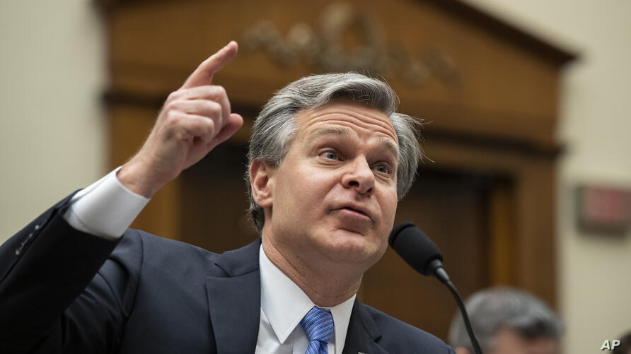 FILE - In this Feb. 5, 2020 file photo, FBI Director Christopher Wray testifies during an oversight hearing of the House…