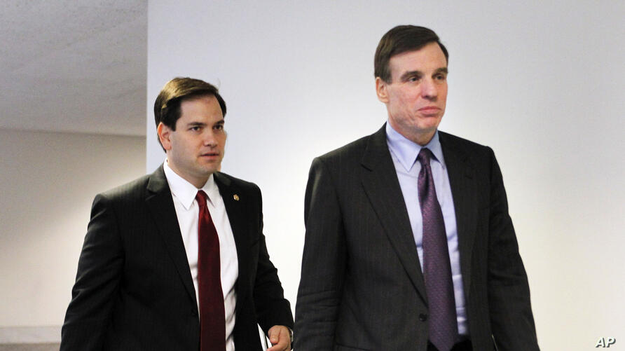 Senate Select Committee on Intelligence members Sens. Marco Rubio, R-Fla., left, and Mark Warner, D-Va., arrive for a closed…