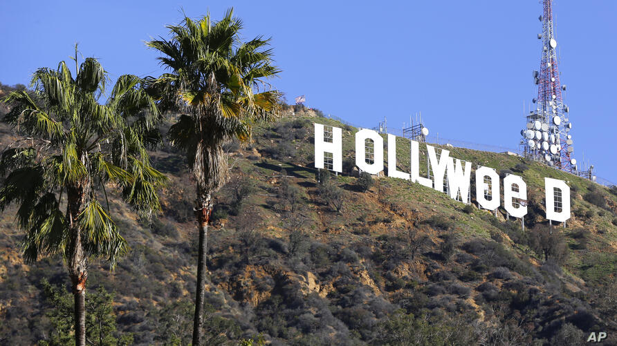 FILE - In this Sunday, Jan. 1, 2017, file photo, the Hollywood sign is seen vandalized. Los Angeles residents awoke New Year's…
