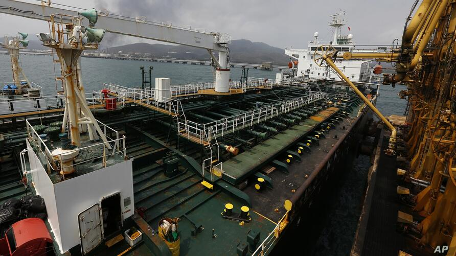 Iranian oil tanker Fortune is anchored at the dock of the El Palito refinery near Puerto Cabello, Venezuela, Monday, May 25,…