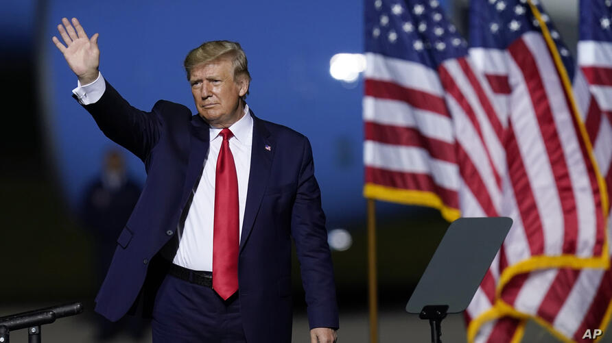 President Donald Trump waves after speaking at a campaign rally Friday, Sept. 25, 2020, in Newport News, Va. (AP Photo/Steve…