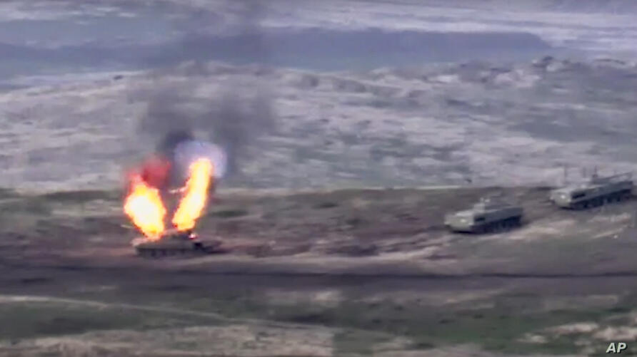 In this image taken from a footage released by Armenian Defense Ministry on Sunday, Sept. 27, 2020, Armenian forces destroy…