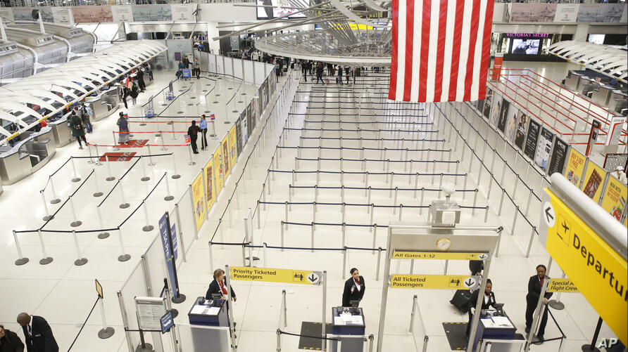 The area for TSA screening of travelers at JFK airport's Terminal 1 is relatively empty, Friday, March 13, 2020, in New York…