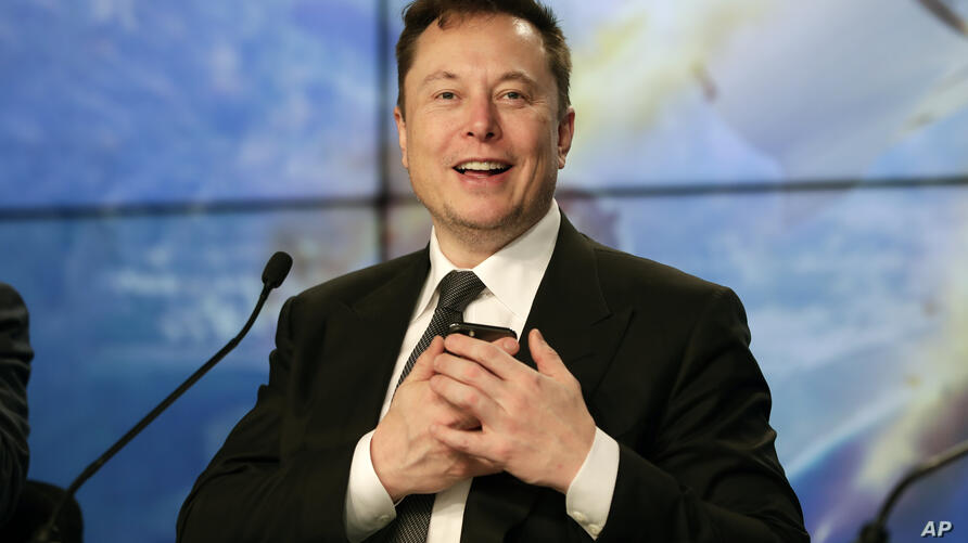 FILE - In this Sunday, Jan. 19, 2020. file photo, Elon Musk founder, CEO, and chief engineer/designer of SpaceX speaks during a…