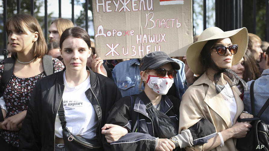 """Belarus students with a banner reading """"Is power more precious than our lives?"""", attend a rally in Minsk, Belarus, Tuesday,…"""