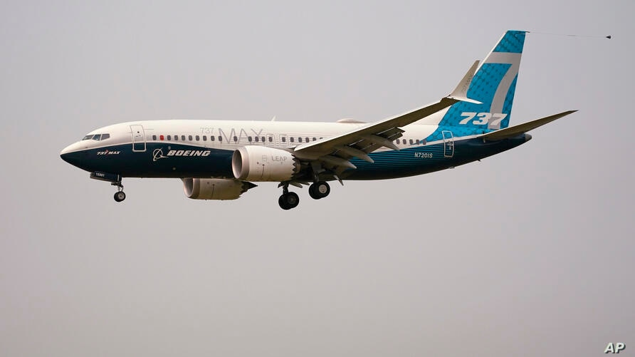 A Boeing 737 MAX jet, piloted by Federal Aviation Administration (FAA) chief Steve Dickson, prepares to land at Boeing Field…