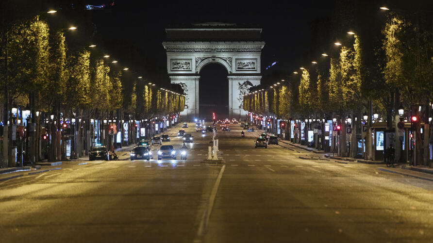 Champs-Elysees avenue is almost empty during curfew in Paris, Saturday, Oct. 17, 2020. French restaurants, cinemas and theaters…