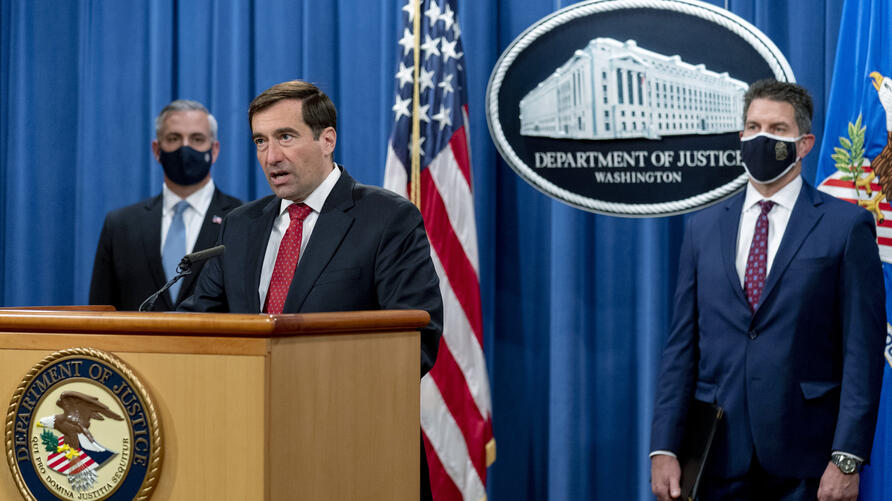 Assistant Attorney General for the National Security Division John Demers, second from left, accompanied by U.S. Attorney for…