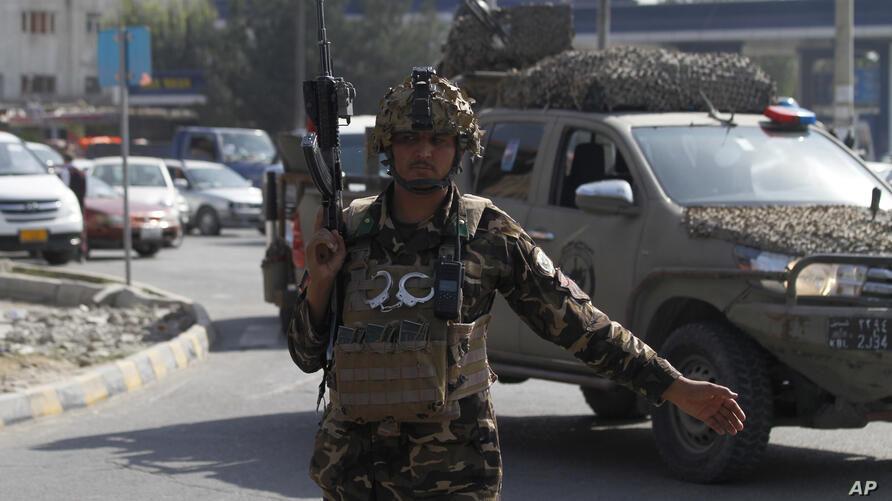 An Afghan security personnel stand guard after an explosion in Kabul, Afghanistan, Wednesday, Sept. 9, 2020. Afghanistan's…