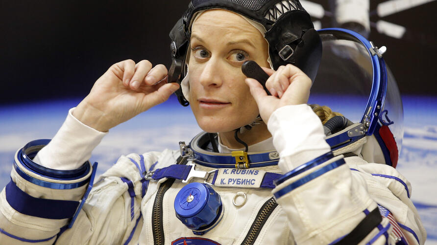 U.S. astronaut Kate Rubins, member of the main crew of the expedition to the International Space Station (ISS), gestures prior…