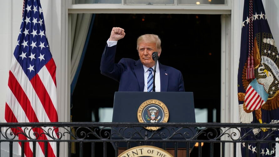 President Donald Trump speaks from the Blue Room Balcony of the White House to a crowd of supporters, Saturday, Oct. 10, 2020,…