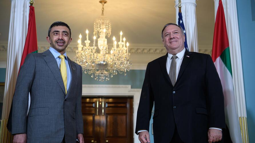 Secretary of State Mike Pompeo, right, stands with United Arab Emirates Foreign Minister Abdullah bin Zayed al-Nahyan, during a…