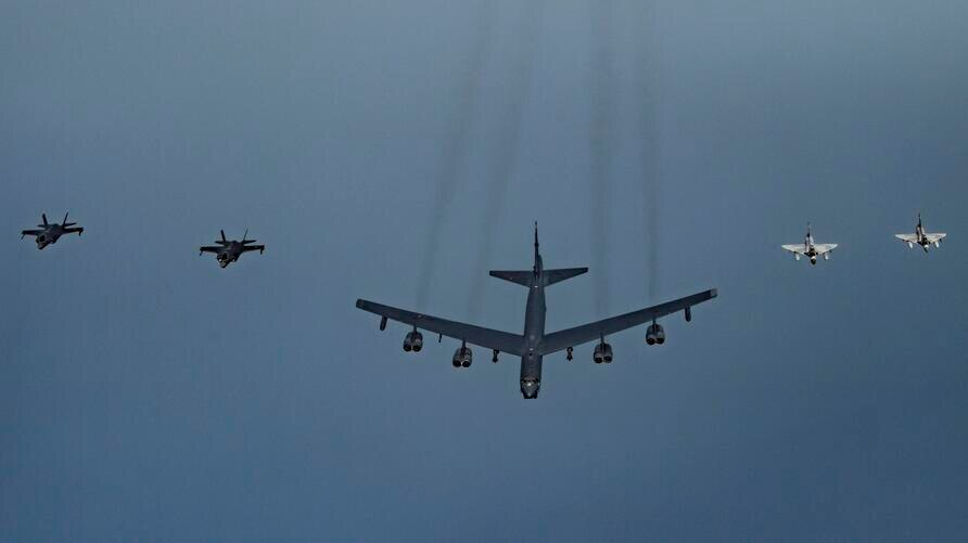 In this Tuesday, May 21, 2019 photo, Qatari Air Force Mirage 2000s, right, a U.S. B-52H Stratofortress, center, and U.S. F-35A…