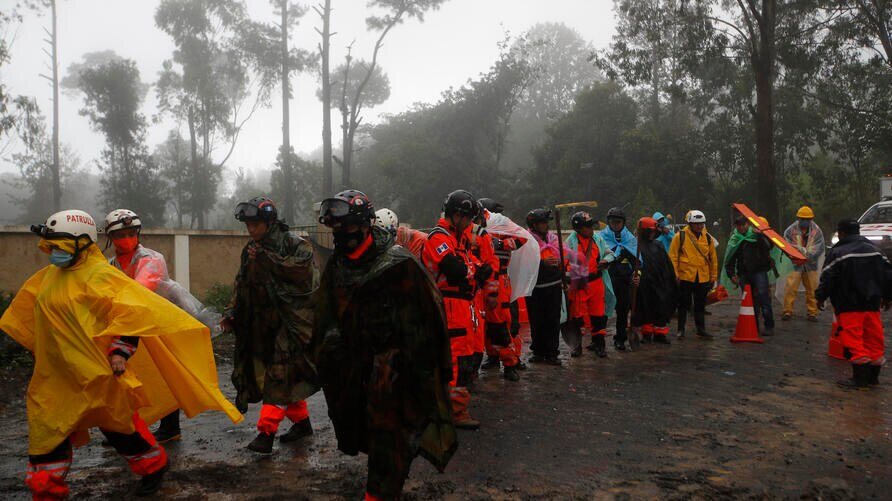 Volunteer firefighters take part in a search and rescue operation in San Cristobal Verapaz, Saturday, Nov. 7, 2020, in the…