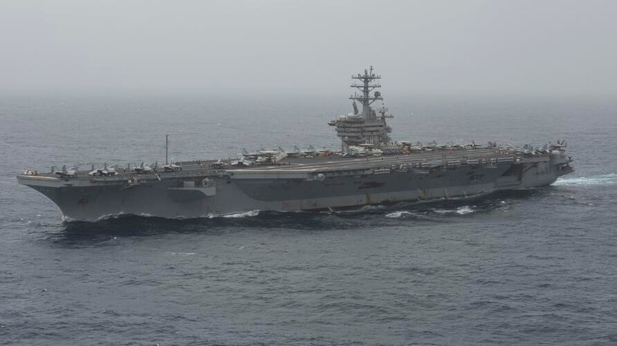 In this Aug. 17, 2020 photo released by the U.S. Navy, the aircraft carrier USS Nimitz transits the Arabian Sea. The U.S. Navy…