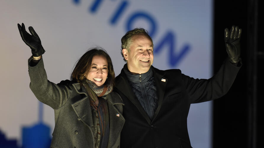 Democratic vice presidential candidate Sen. Kamala Harris, D-Calif., and her husband Doug Emhoff take the stage during a drive…
