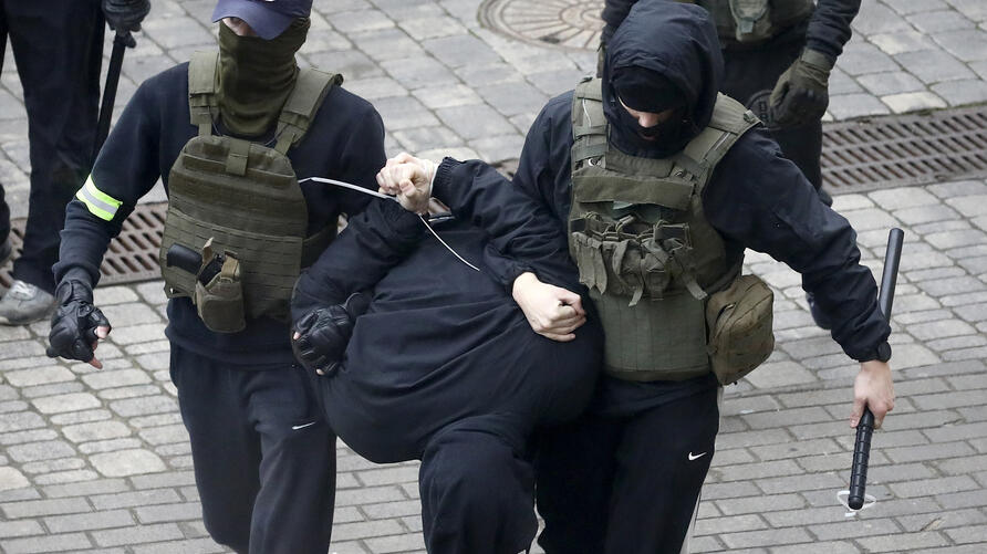 Police detain a man during an opposition rally to protest the official presidential election results in Minsk, Belarus, Sunday,…