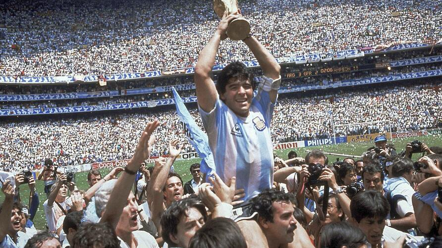 FILE - In this June 29, 1986 file photo, Diego Maradona holds up his team's trophy after Argentina's 3-2 victory over West…
