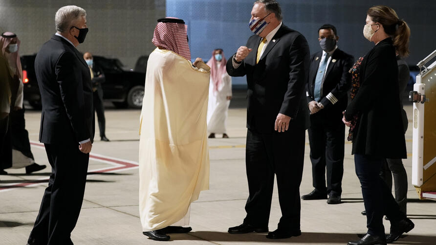 U.S. Ambassador to Saudi Arabia John Abizaid, left, and Saudi Arabia's Foreign Minister Faisal bin Farhan, second from left,…
