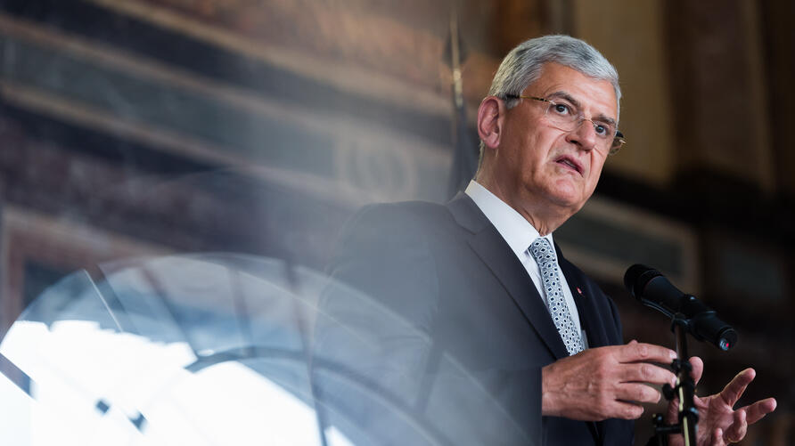 Turkey's EU Affairs Minister Volkan Bozkir addresses the media after a meeting with Belgium Foreign Minister Didier Reynders at…