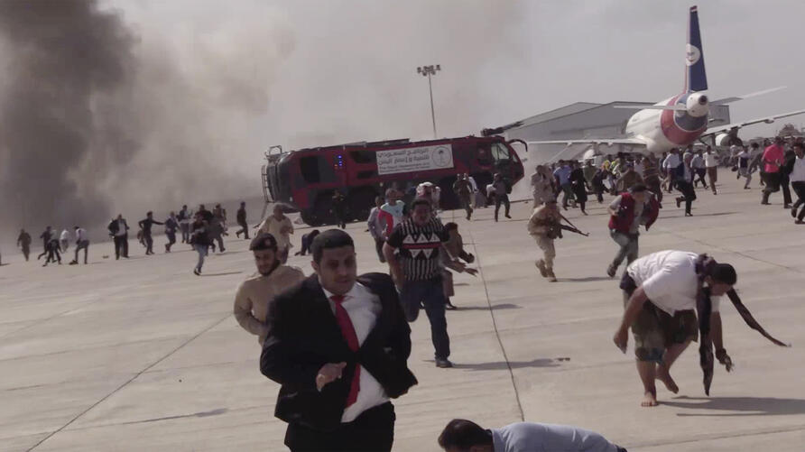 People run following an explosion at the airport in Aden, Yemen, shortly after a plane carrying the newly formed Cabinet landed…