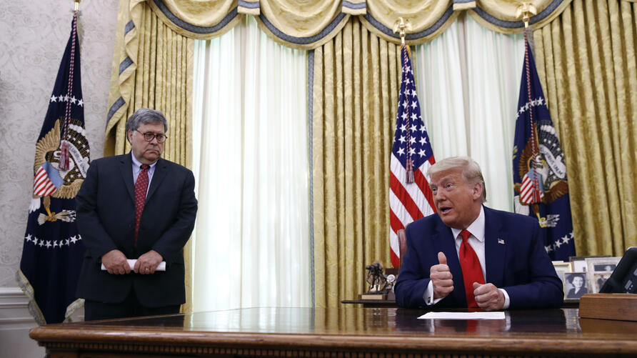 FILE - In this June 15, 2020, file photo President Donald Trump speaks alongside Attorney General William Barr during a law…