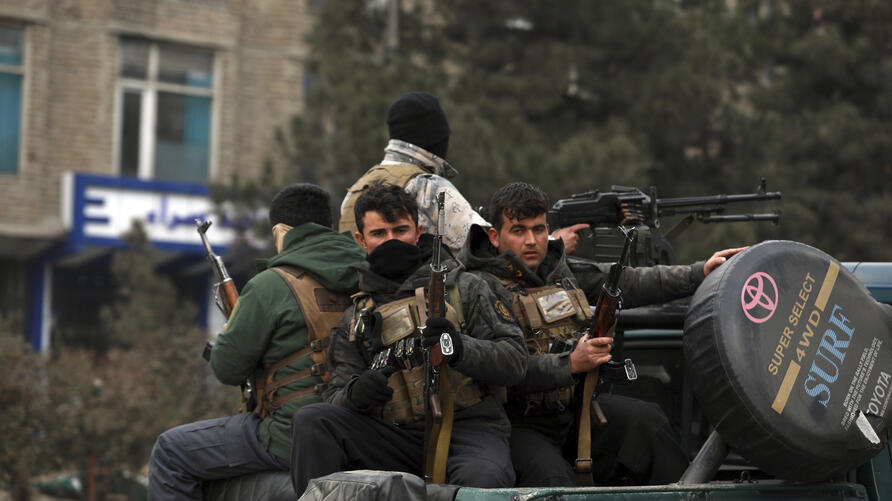 Afghan security personnel arrive at the site of a bomb attack in Kabul, Afghanistan, Saturday, Dec. 26, 2020. A series of…