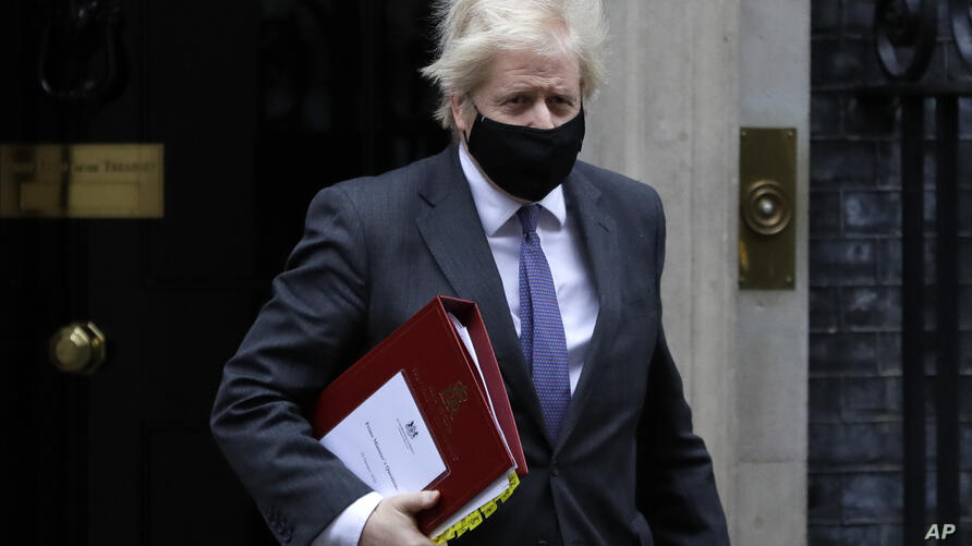 Britain's Prime Minister Boris Johnson leaves Downing Street to attend the weekly session of PMQs in parliament in London,…
