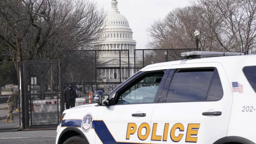 Security surrounds the U.S. Capitol in Washington, Friday, Jan. 15, 2021, ahead of the inauguration of President-elect Joe…