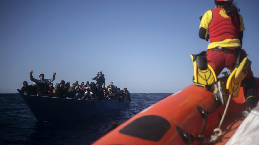 Migrants from Eritrea, Egypt, Syria and Sudan, are assisted by aid workers of the Spanish NGO Open Arms, after fleeing Libya on…