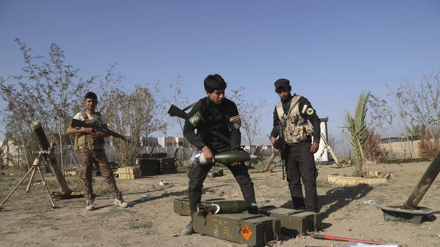 FILE - In this March 15, 2015 file photo, young Shiite volunteer militia members prepare to attack Islamic State fighters in…
