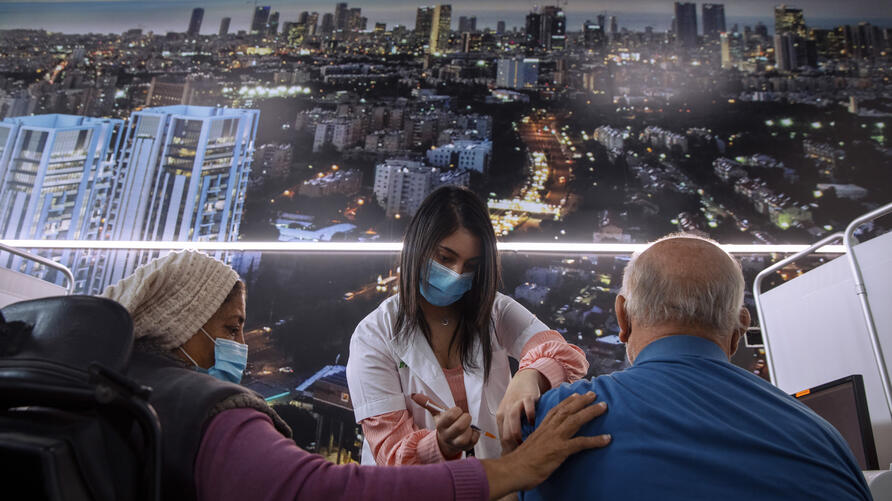 An Israeli man receives the second dose of the Pfizer-BioNTech COVID-19 vaccine at a coronavirus vaccination center in Tel Aviv…