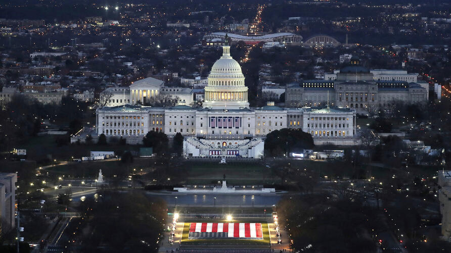 """The U.S. Capitol building is prepared for the inauguration ceremonies for President-elect Joe Biden as the """"Field of Flags"""" are…"""