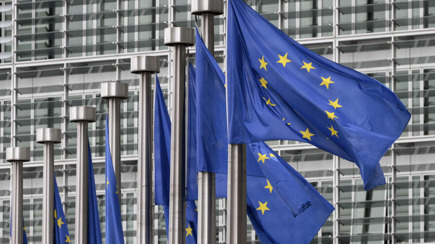 FILE - In this May 9, 2011 file photo, EU flags fly outside the European Commission headquarters in Brussels. Disinformation…