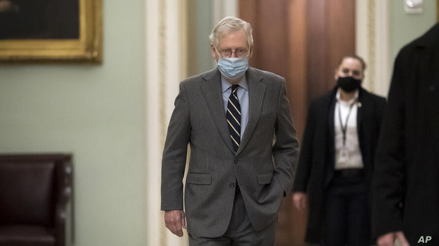 Senate Minority Leader Mitch McConnell, R-Ky., arrives at the Capitol in Washington, Tuesday, Jan. 26, 2021. (AP Photo/J. Scott…