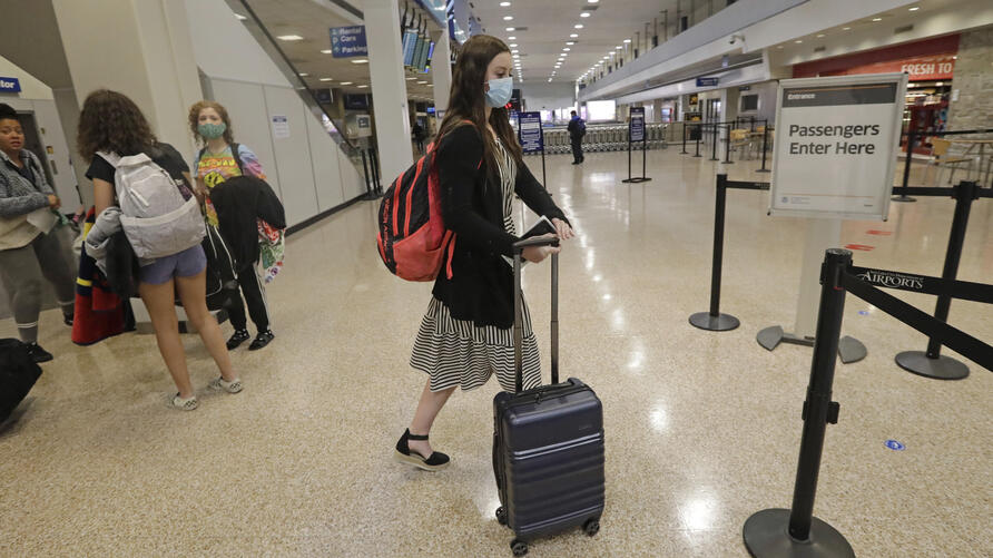 In this May 27, 2020, photo, Shaelee Palmer, 20, right, a missionary from The Church of Jesus Christ of Latter-day Saints,…