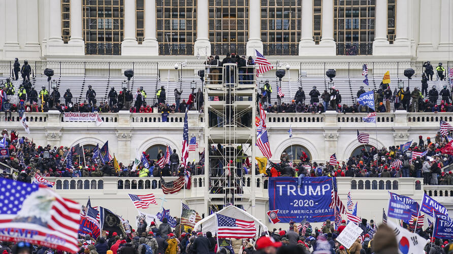 Trump supporters gather outside the Capitol, Wednesday, Jan. 6, 2021, in Washington. As Congress prepares to affirm President…