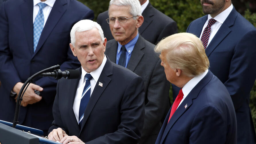 Vice President Mike Pence looks at President Donald Trump during a news conference about the coronavirus in the Rose Garden at…