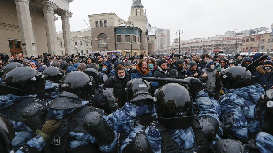 People clash with police during a protest against the jailing of opposition leader Alexei Navalny in Moscow, Russia, Sunday,…