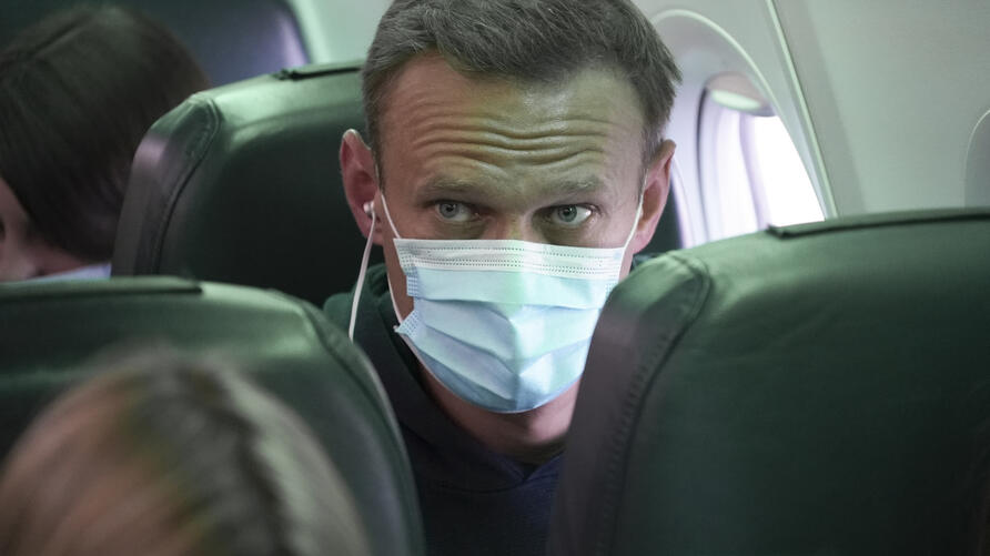 Alexei Navalny sits on the plane prior to a flight to Moscow, at the Airport Berlin Brandenburg (BER) in Schoenefeld, near…