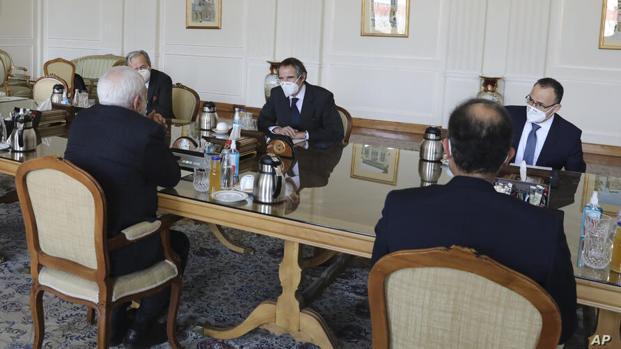 Director General of International Atomic Energy Agency, IAEA, Rafael Mariano Grossi, center, meets with Iranian Foreign…