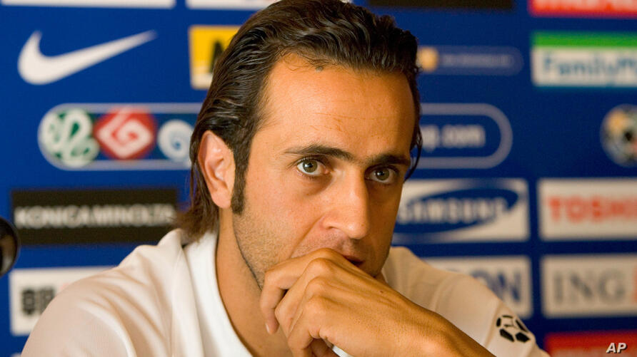 Iran's midfielder Ali Karimi listens to questions from journalists during an Asian Cup soccer tournament pre-match press…