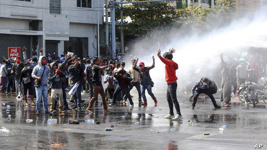 Police use water cannon to disperse demonstrators during a protest in Mandalay, Myanmar, Tuesday, Feb. 9, 2021. Police were…