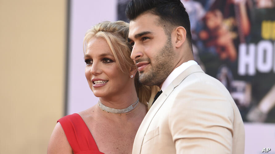 """Britney Spears and Sam Asghari arrive at the Los Angeles premiere of """"Once Upon a Time in Hollywood,"""" at the TCL Chinese…"""