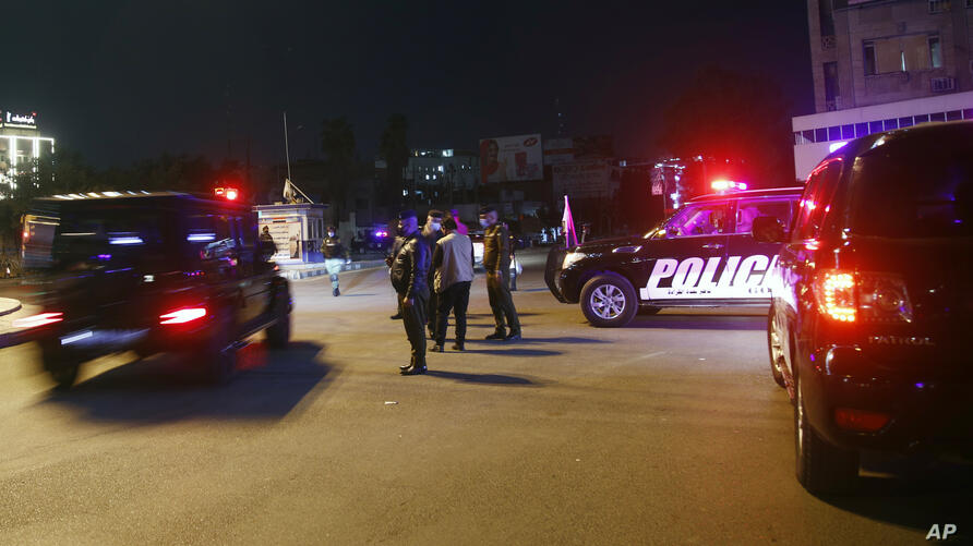 Security forces patrol in the empty streets of Baghdad at the start of the new curfew to counter the spread of COVID-19…