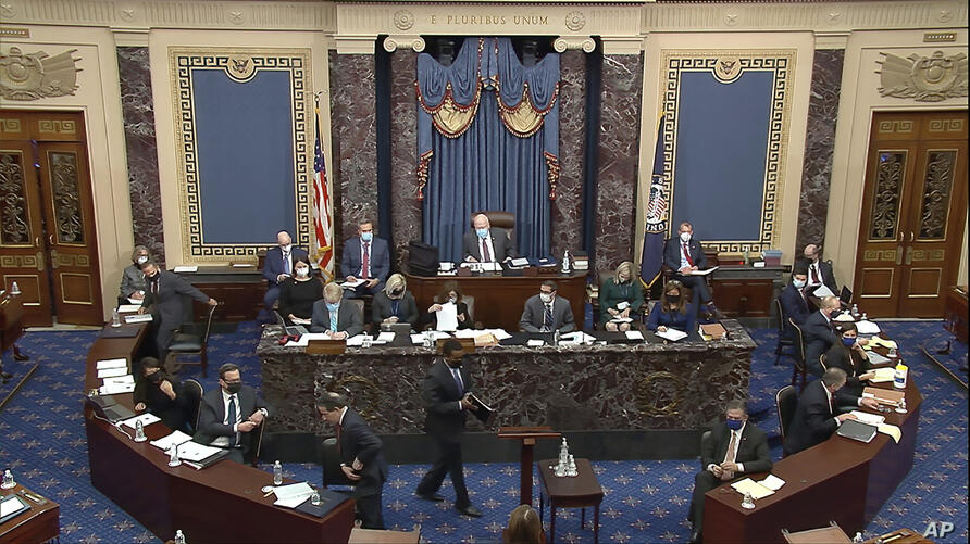In this image from video, House impeachment manager Rep. Joe Neguse, D-Colo., prepares to speak during the second impeachment…