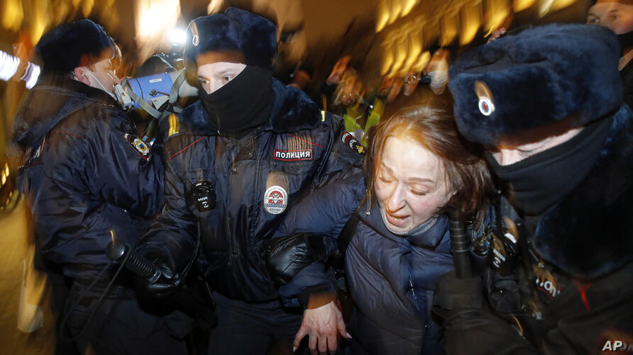 Police officers detain a Navalny supporter during a protest in St. Petersburg, Russia, Tuesday, Feb. 2, 2021. A Moscow court…